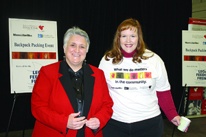 Moore & Van Allen immigration attorney Sarah Buffett (right) with Second Harvest Food Bank director Kay Carter.