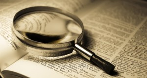 dictionary page magnifying glass