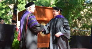 Nick Luft, right, shakes the hand of USC Law Dean Robert Wilcox during the Commencement ceremony on May 8 at the university's Horseshoe. Contributed Photo.