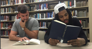 Charleston School of Law student Bradon Childs (left) sits with rapper Waka Flocka Flame at the CSOL library. Photo courtesy Michael Rentz
