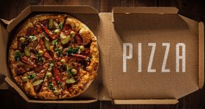 pizza in the in delivery box with pizza text on the wood