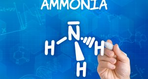 Hand with pen drawing the chemical formula of ammonia